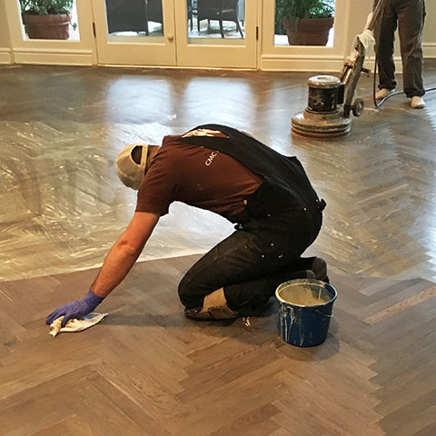 Applying finish to wood floor